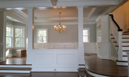Interior painting in Severna Park living room with lots of molding