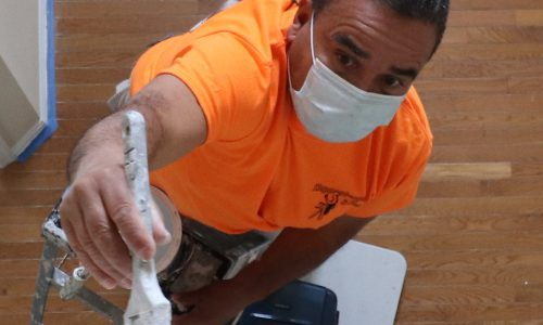 Interior Painter in Sunny Isles painting Foyer on ladder